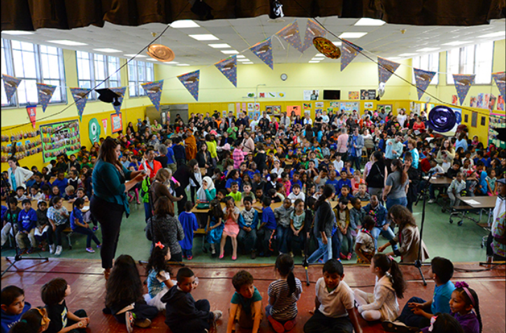 Students gather to watch their peers perform at an Assembly
